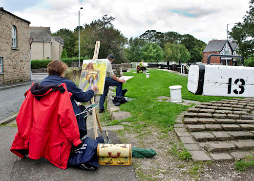 Artists at Lock 13 work on their compositions for an art competion